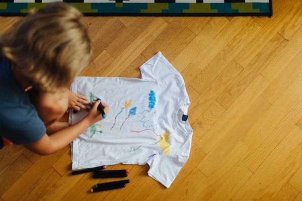 Little Girl Decorating T-Shirt