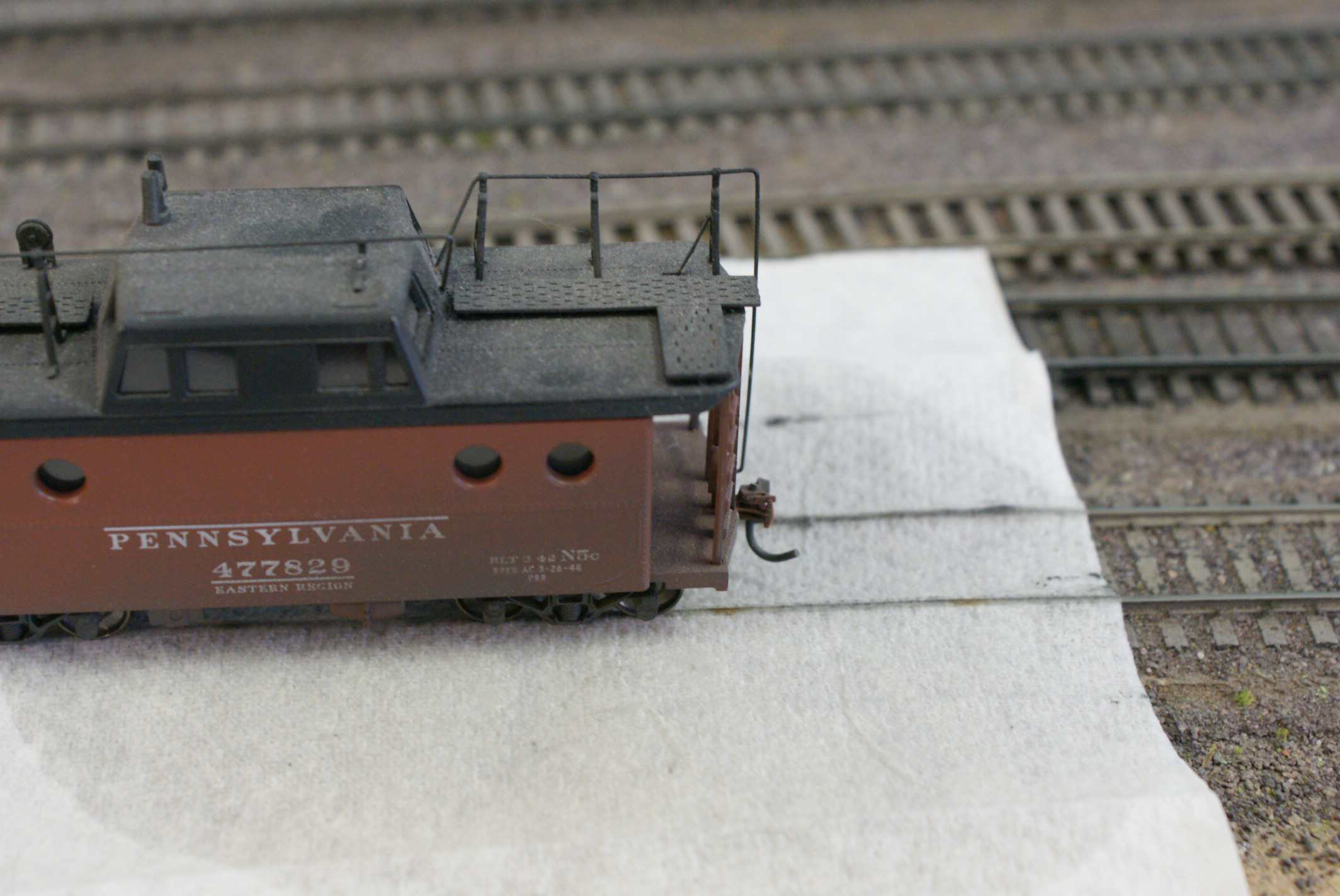 A model train with a paper towel on the track