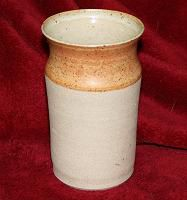 Stoneware vase by unknown potter with pumpkin and clear glazes.