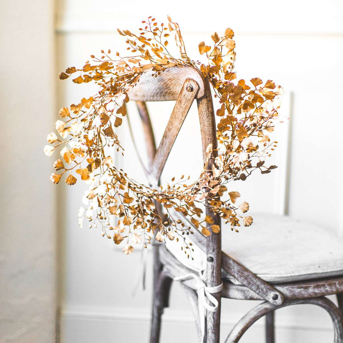 leafy wreath spray-painted gold