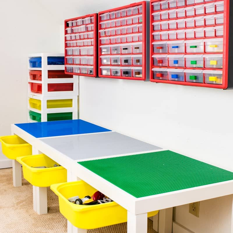 A large Lego table with wall storage