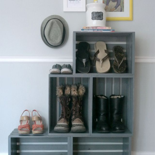 A shoe rack made of crates