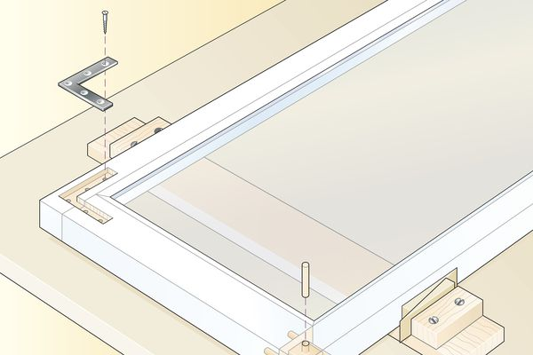 Digital illustration of securing loose joints in casement window with recessed metal angle and glued dowels driven into mortise-and-tenon joints