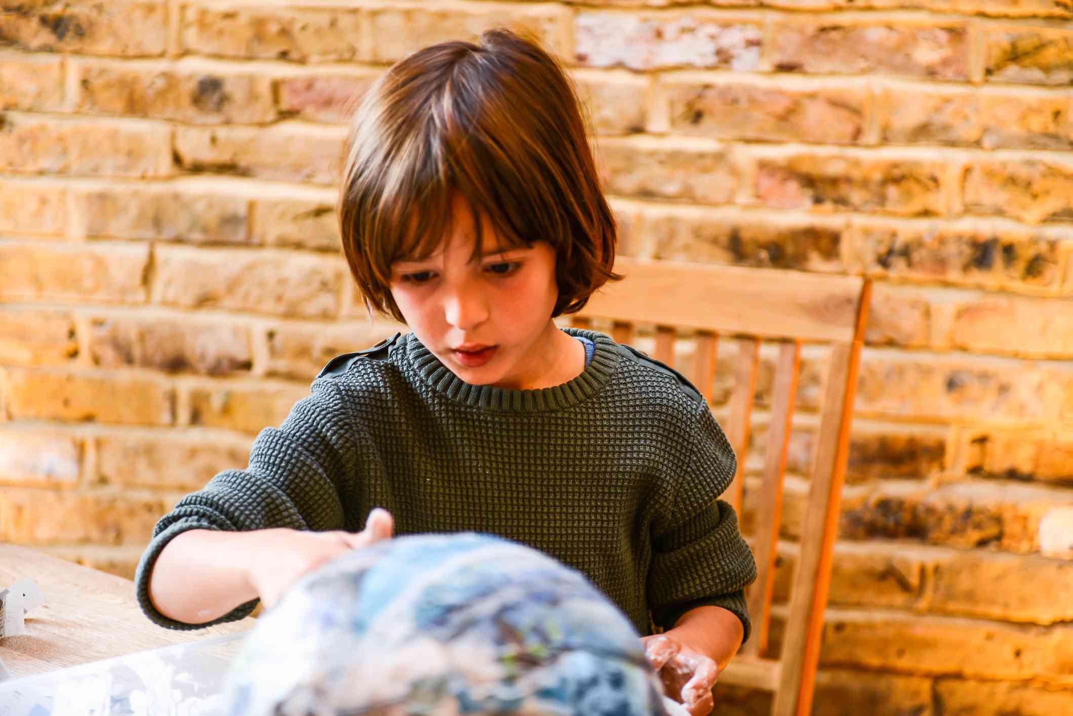 Child with paper mache
