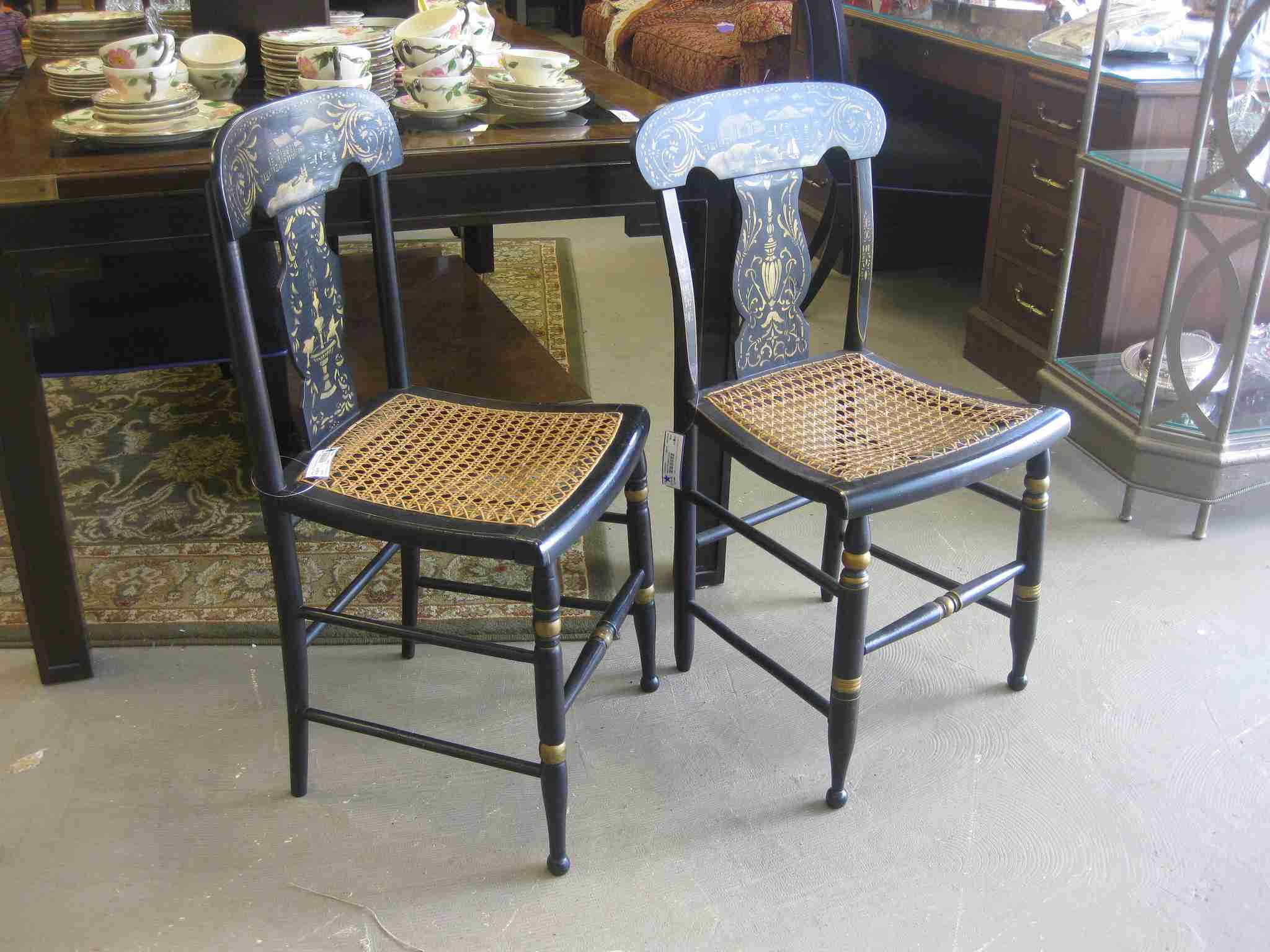 two hitchcock chairs in store