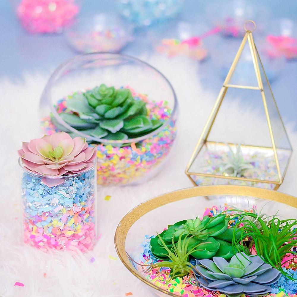 confetti succulent terrarium on a fur background