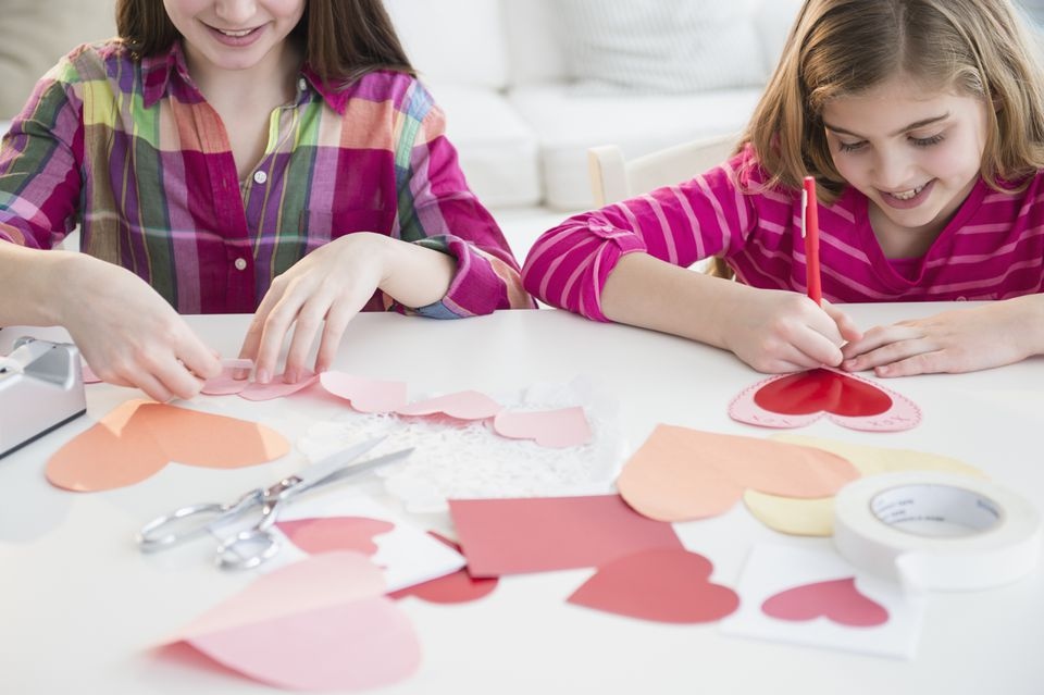 Friends making valentines together