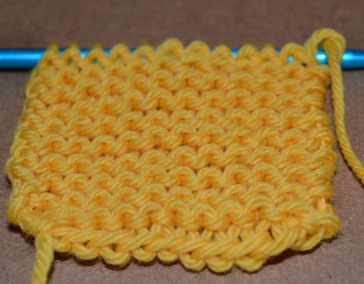 A swatch of garter stitch on a knitting needle