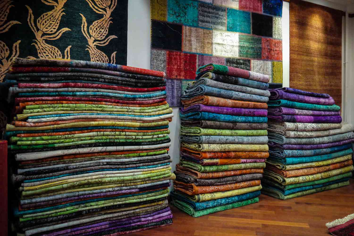 Stacks of quilt fabric against the wall