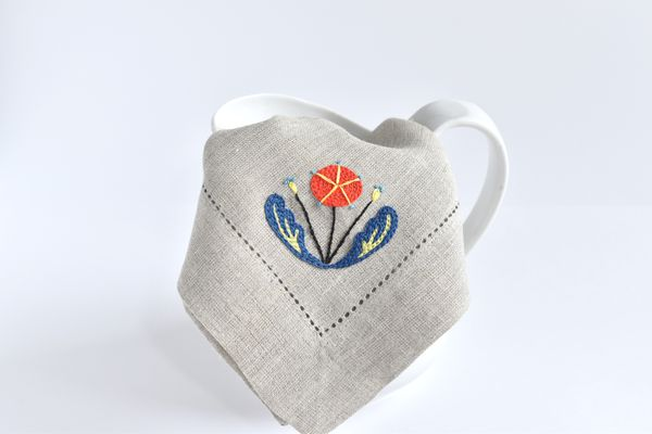 Scandi Embroidered Floral Napkin Folded on a Pitcher