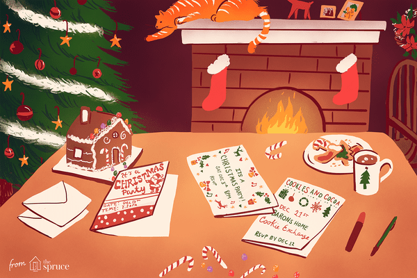 Illustration of free Christmas card printables sitting on a table next to a fireplace and Christmas tree