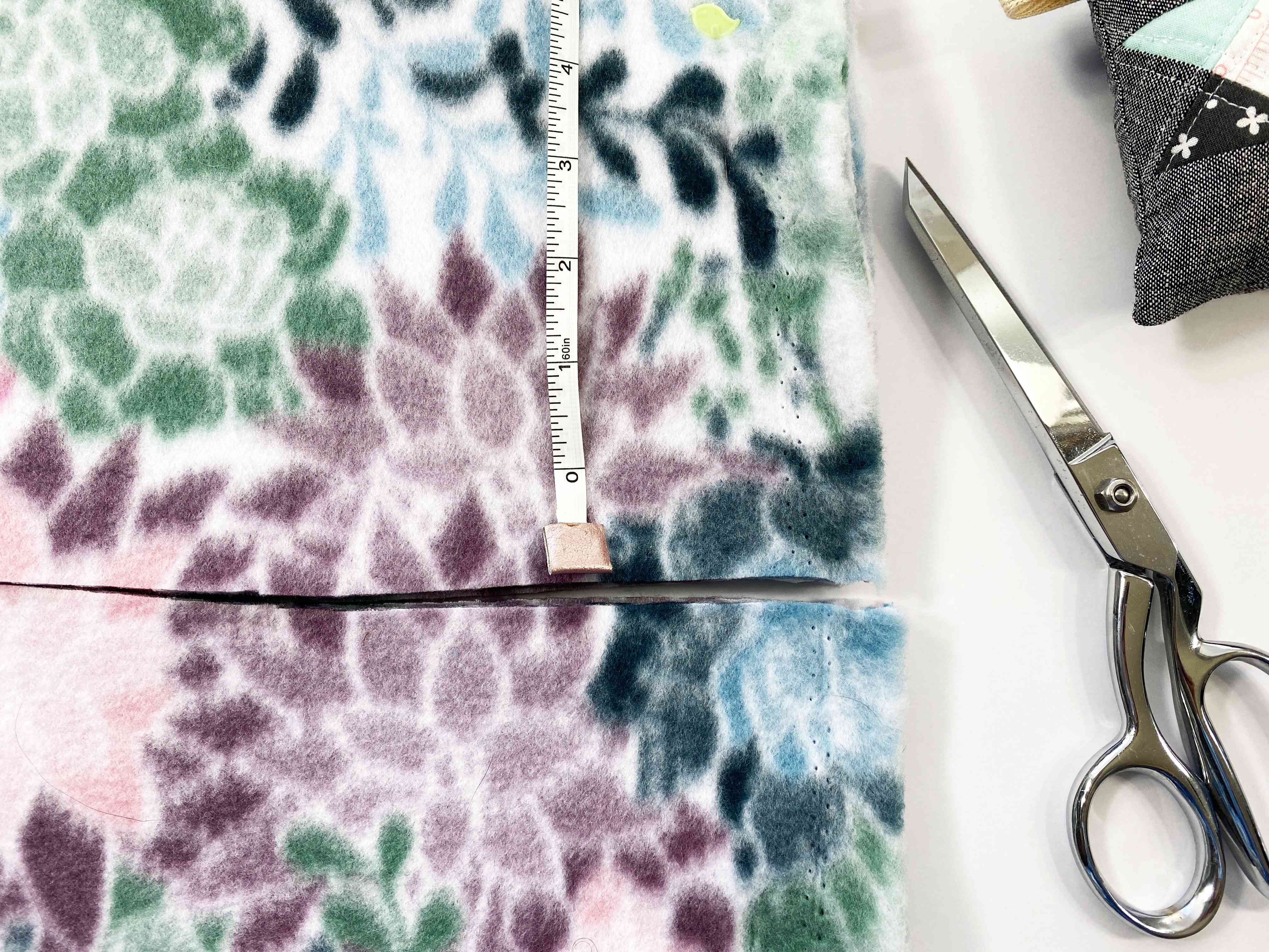 Fabric being measured and cut