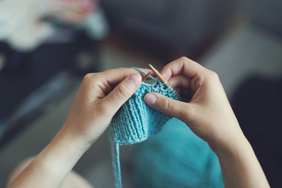 knitting blue yarn