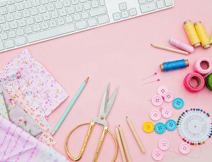 Craft supplies on pink background