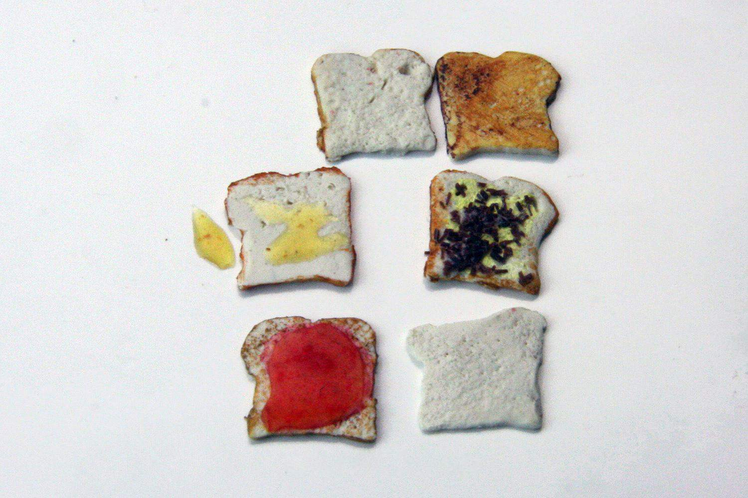Different bread slices with toppings in doll size