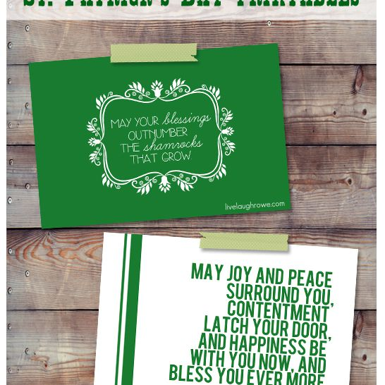 Two St. Patrick's Day cards taped to a wooden wall.