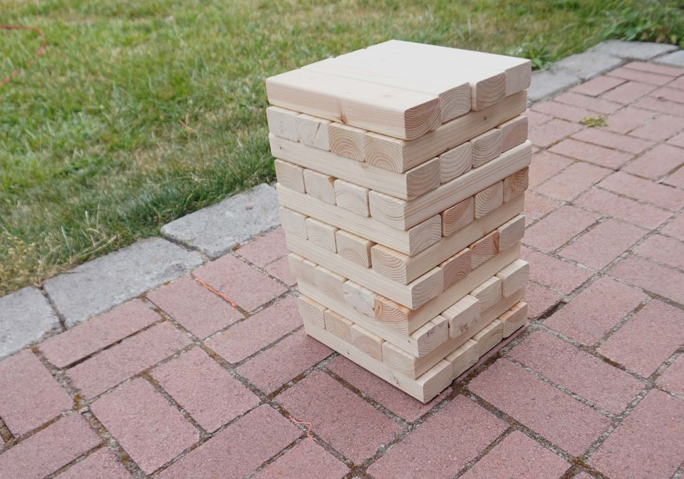 DIY giant Jenga set up on brick patio