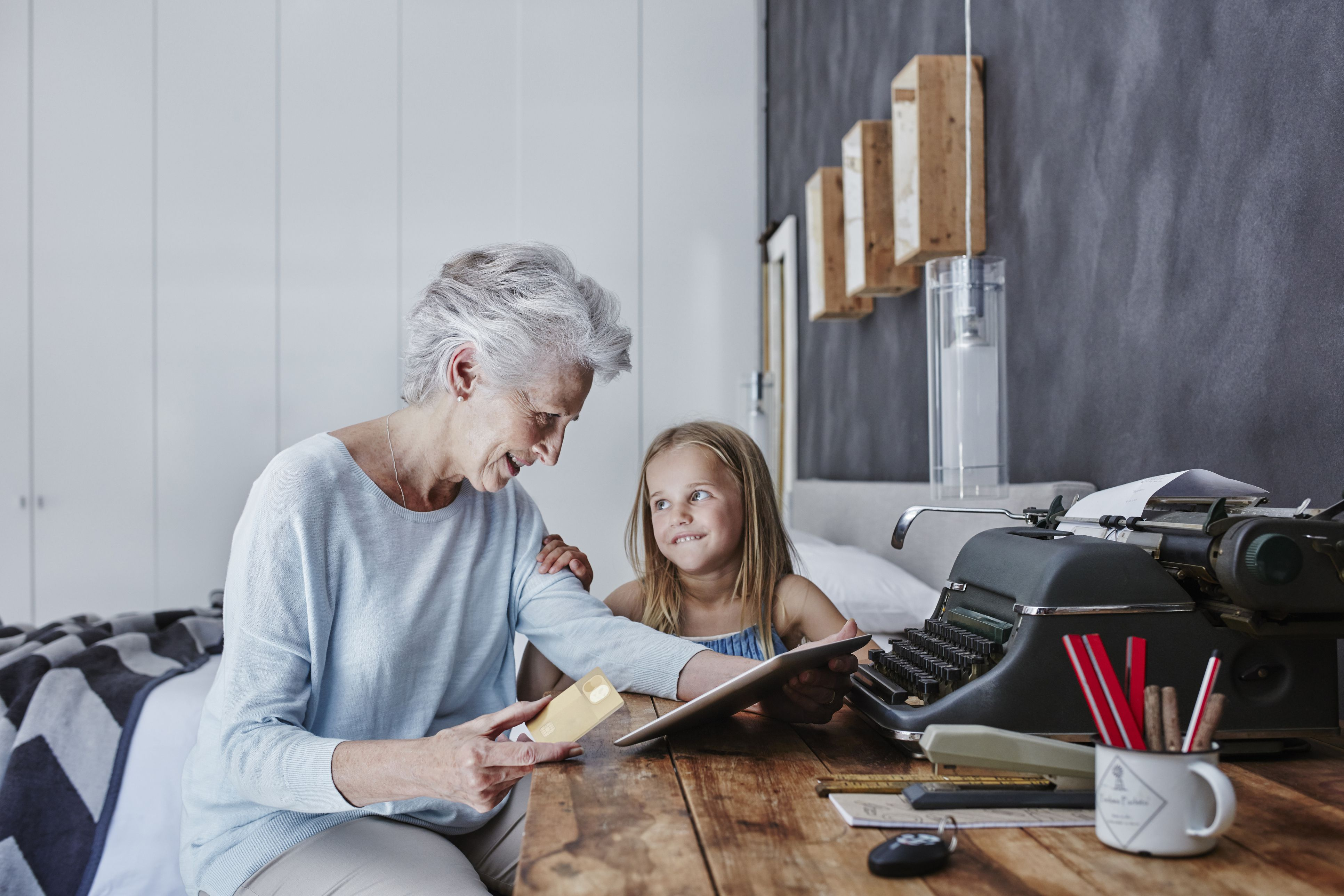 Grandmother and granddaughter spending time at home