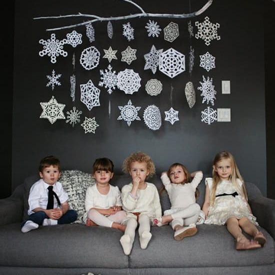 children under paper snowflakes