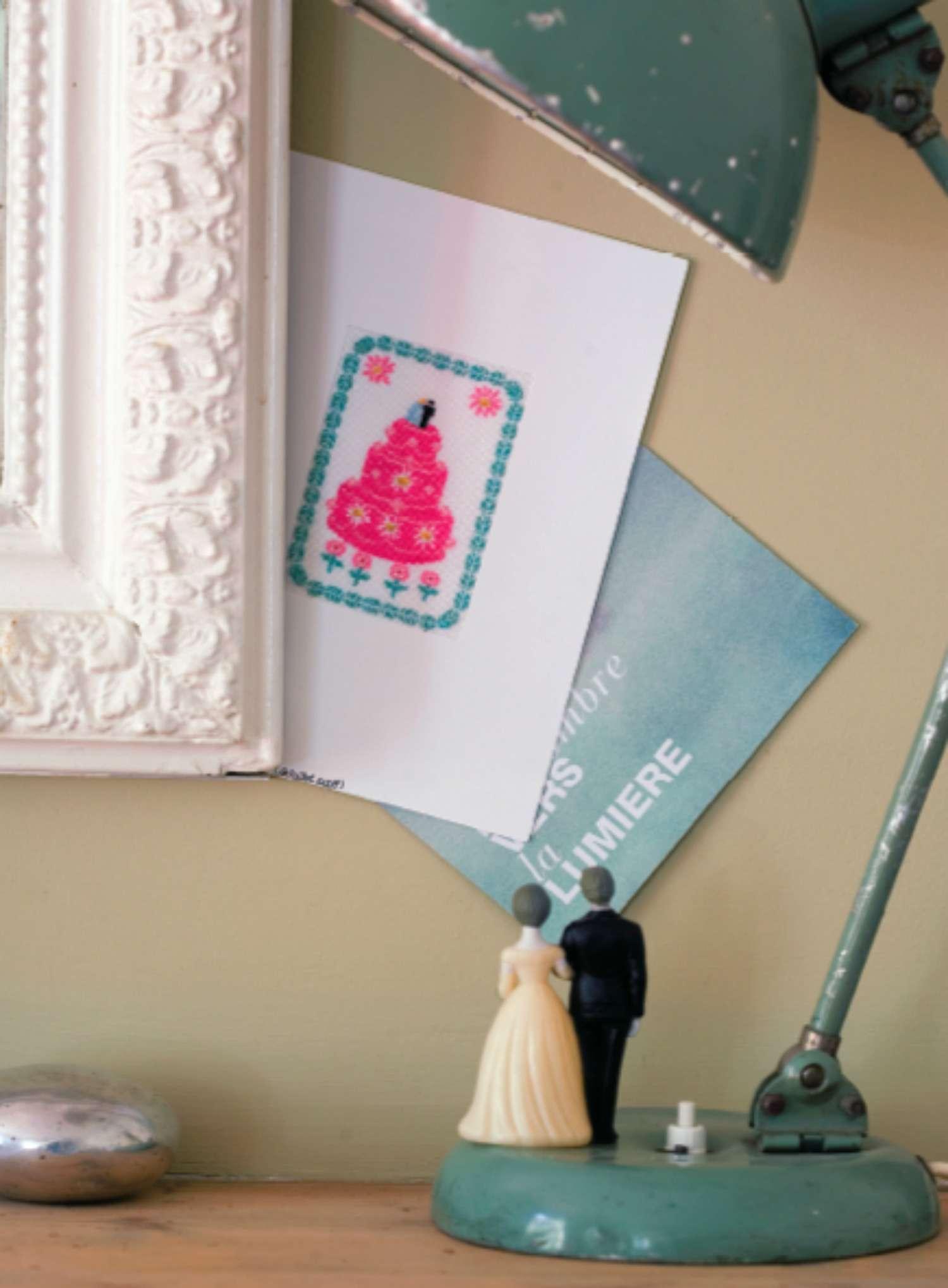 wedding cake cross stitch on wall