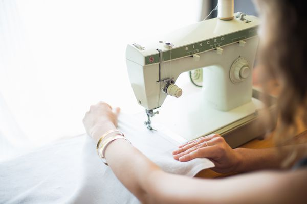 Woman using a sewing machine