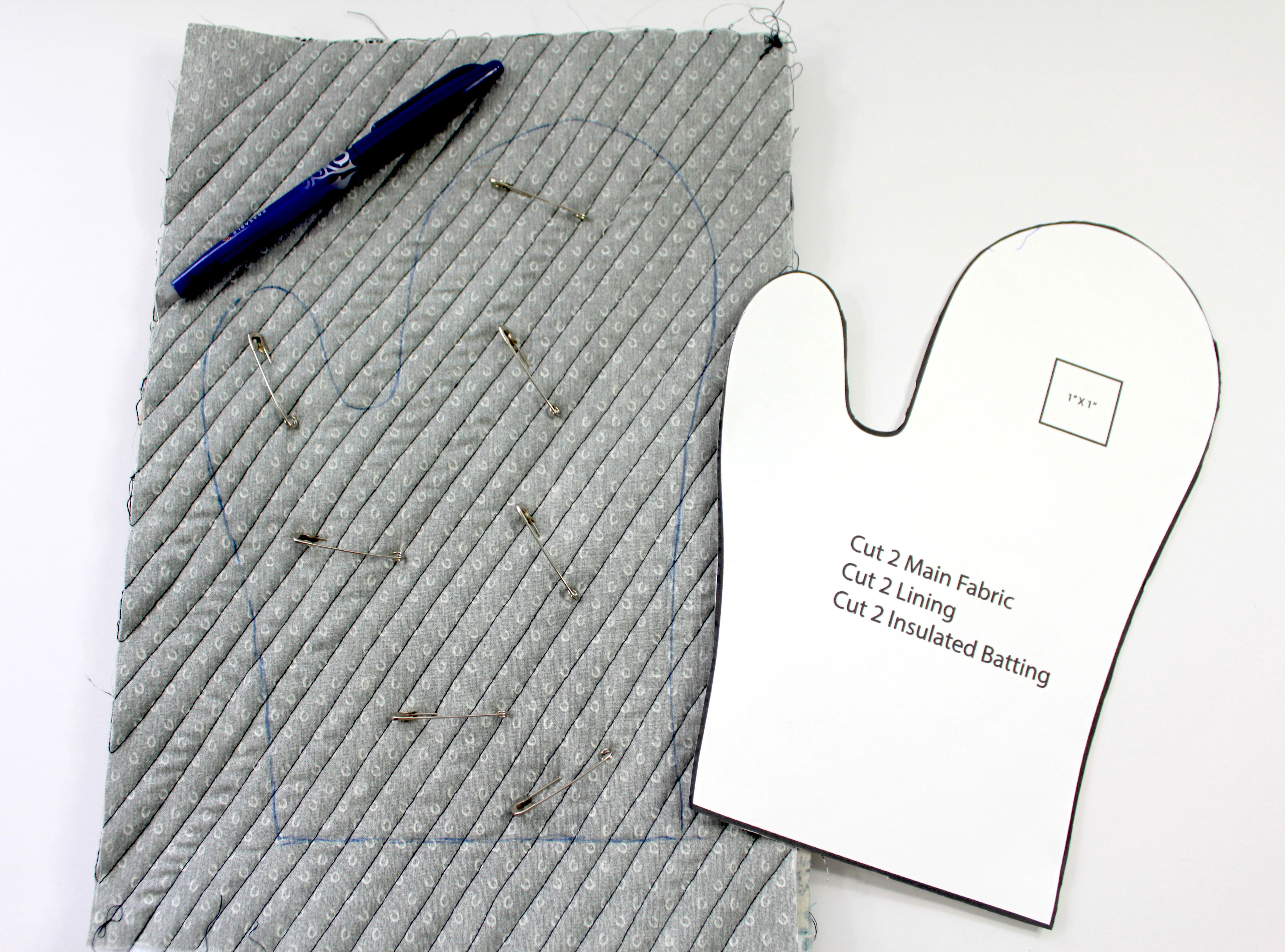 Tracing and basting the oven mitt