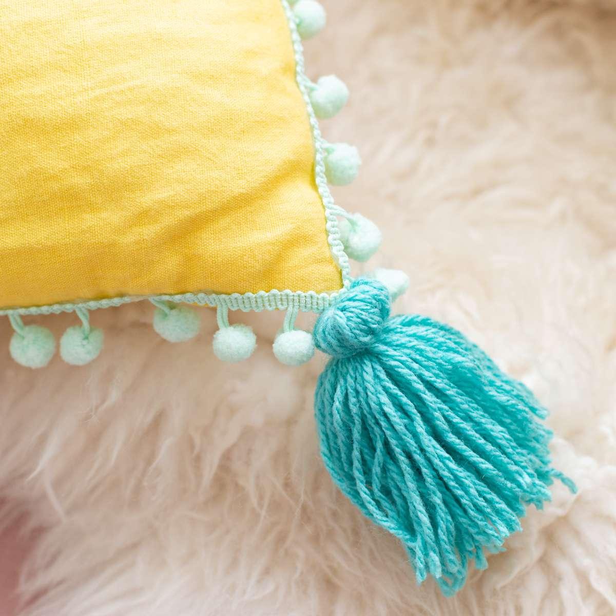 DIY tassel and pompom trim pillow