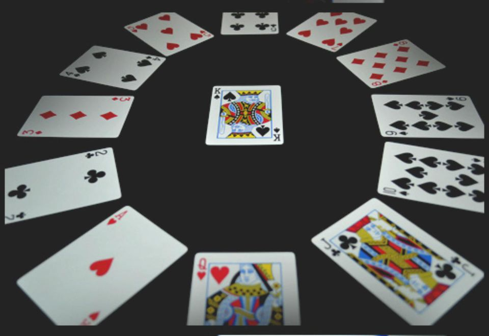 shot of cards set up for clock solitaire