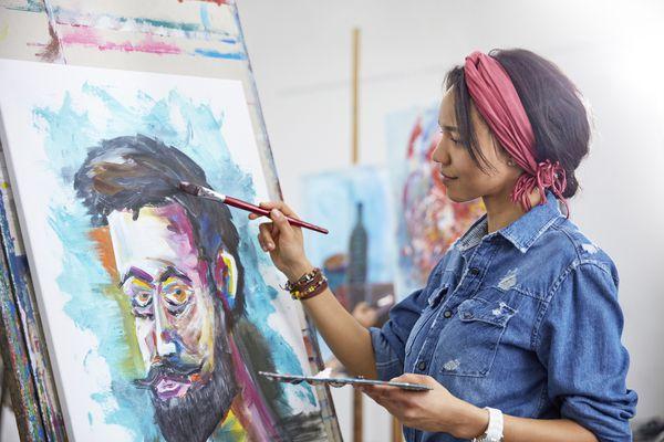 Female artist painting in art studio