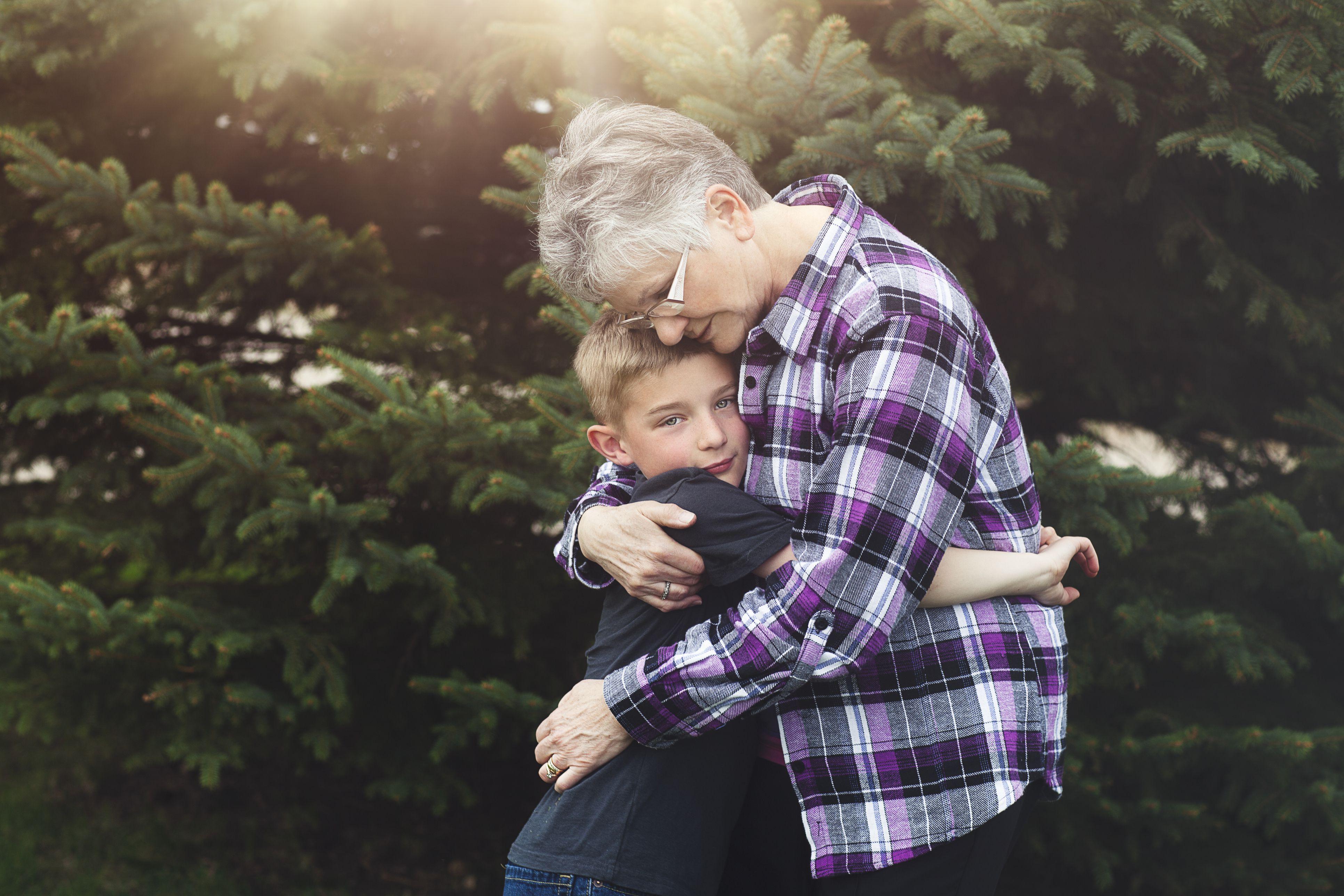 grandmother and grandson embracing