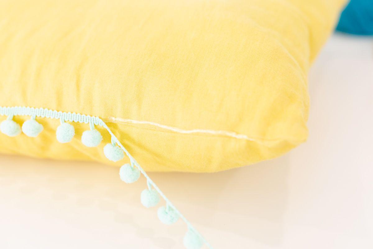 Glueing trim on a pillow