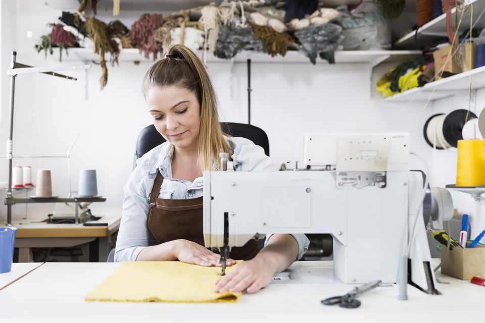 Seamstress at work, in her small business