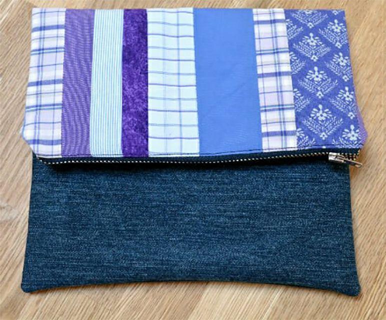 A striped fabric and denim clutch