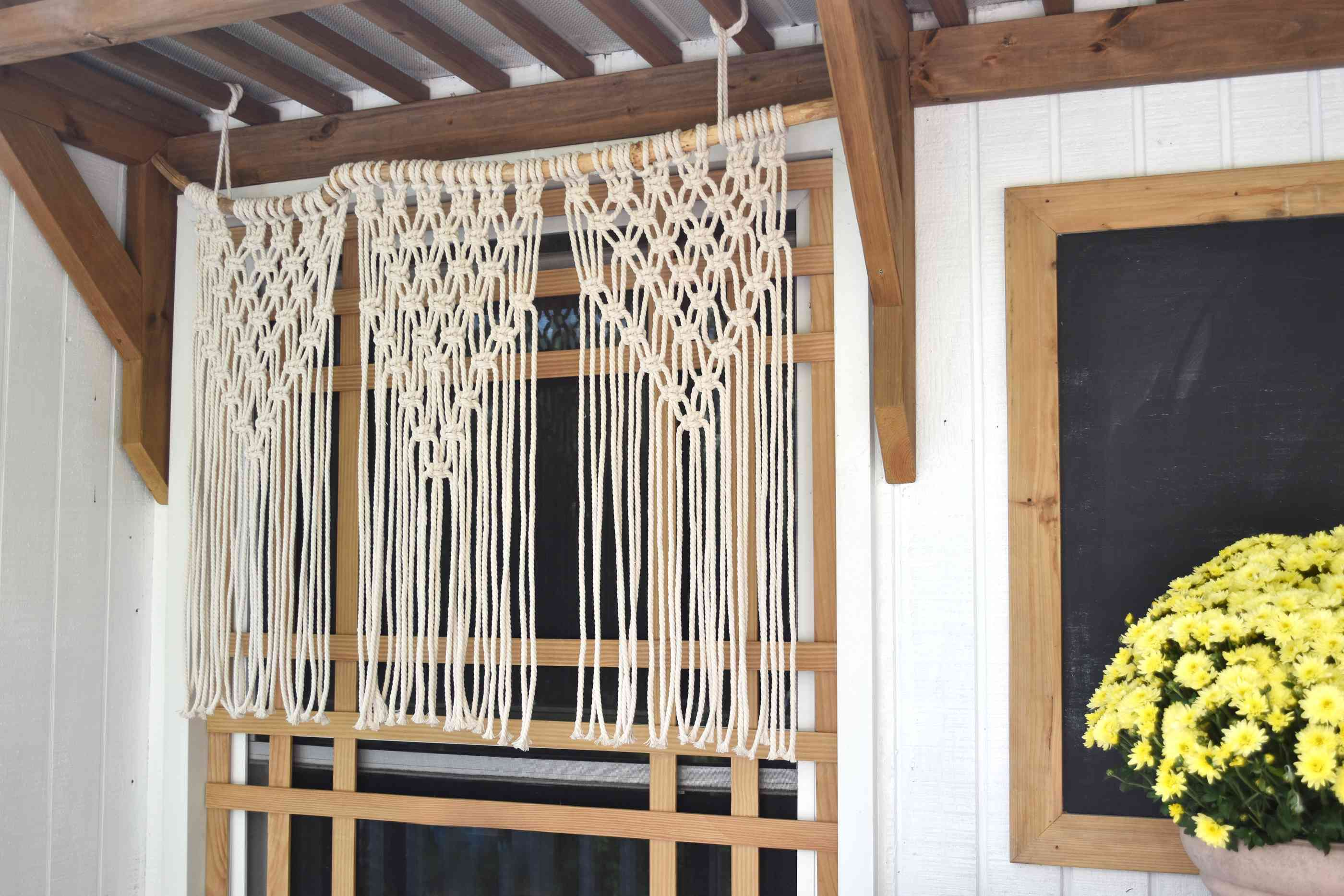 Hang the macrame curtain over a window