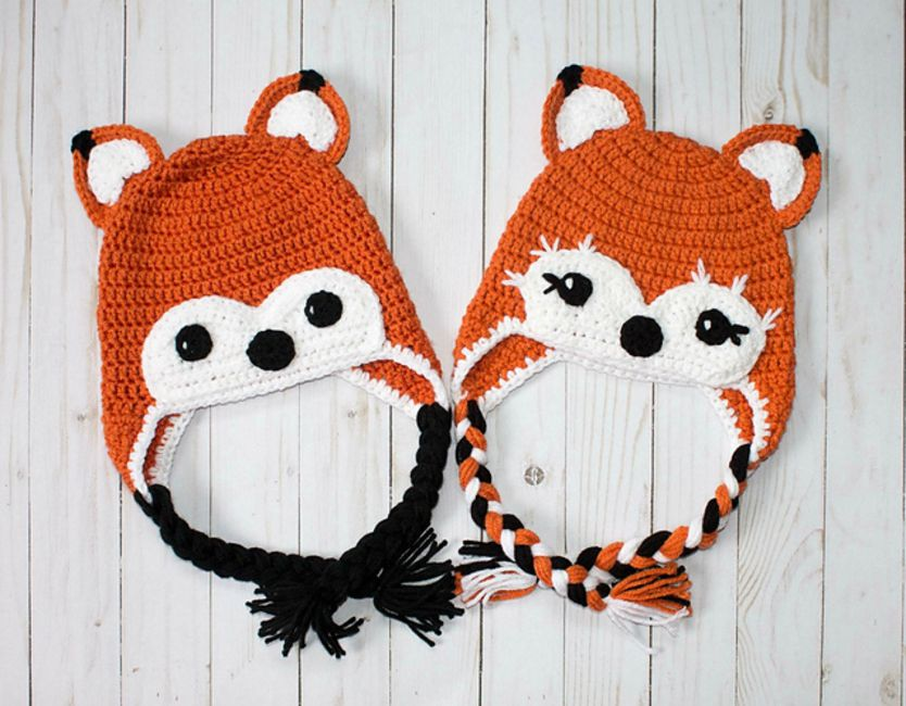 Two crochet fox hats, one female and the other male.