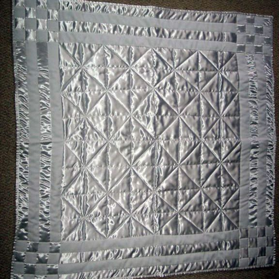 Silver quilt used for a baptism.
