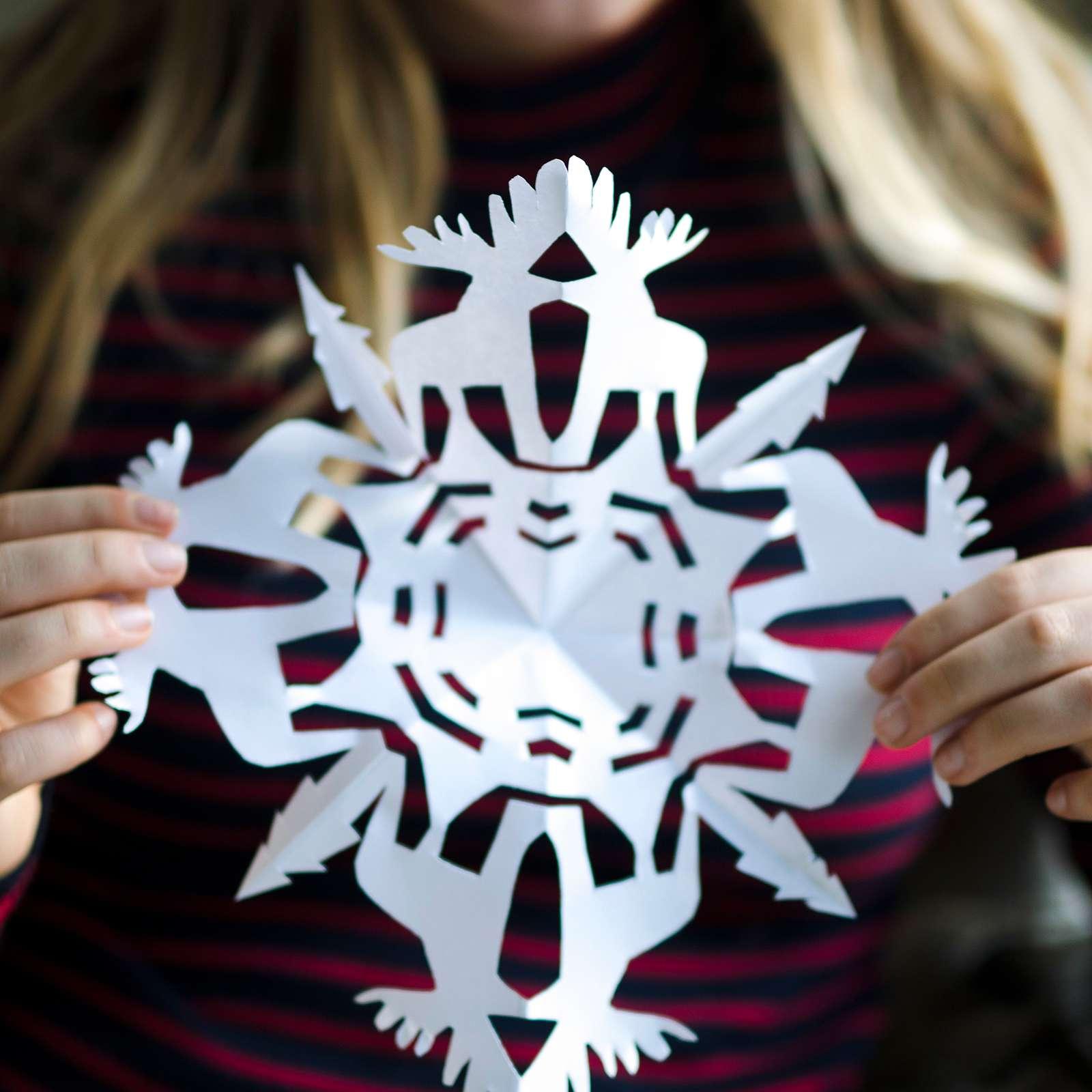 girl holding moose snowflake