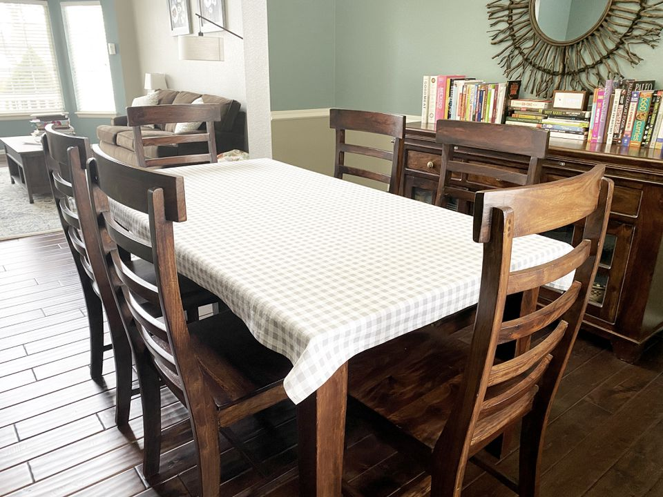 A gingham table cloth in a dining room