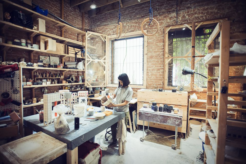Female potter at work in studio