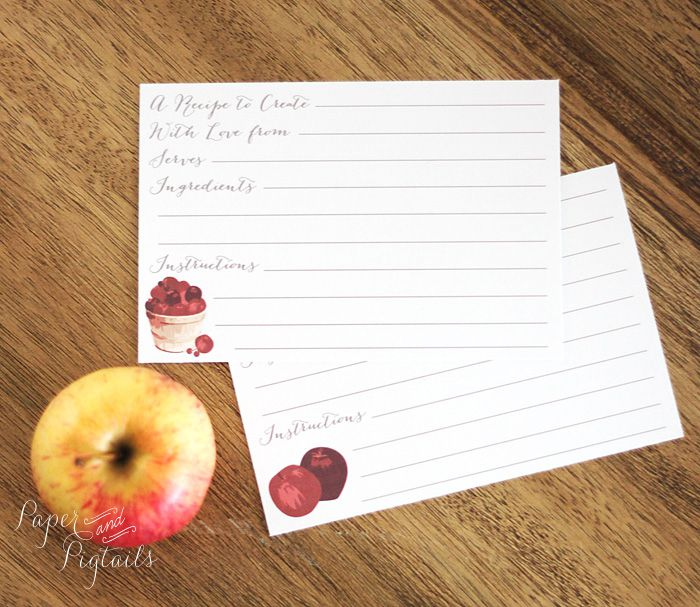 Recipe cards on a table with an apple