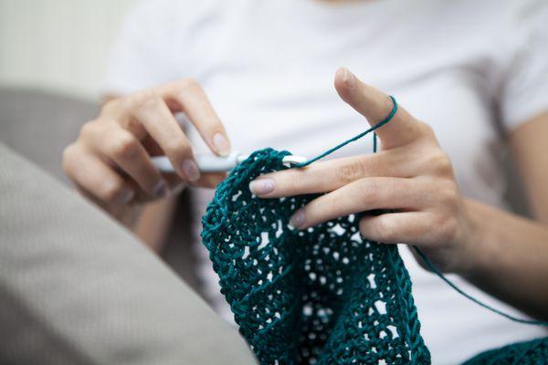 Close-up of hands doing crochet