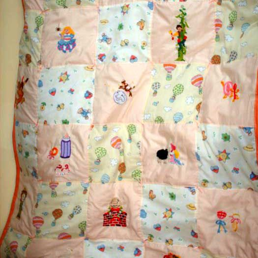 Pink baby quilt featuring nursery rhyme characters.