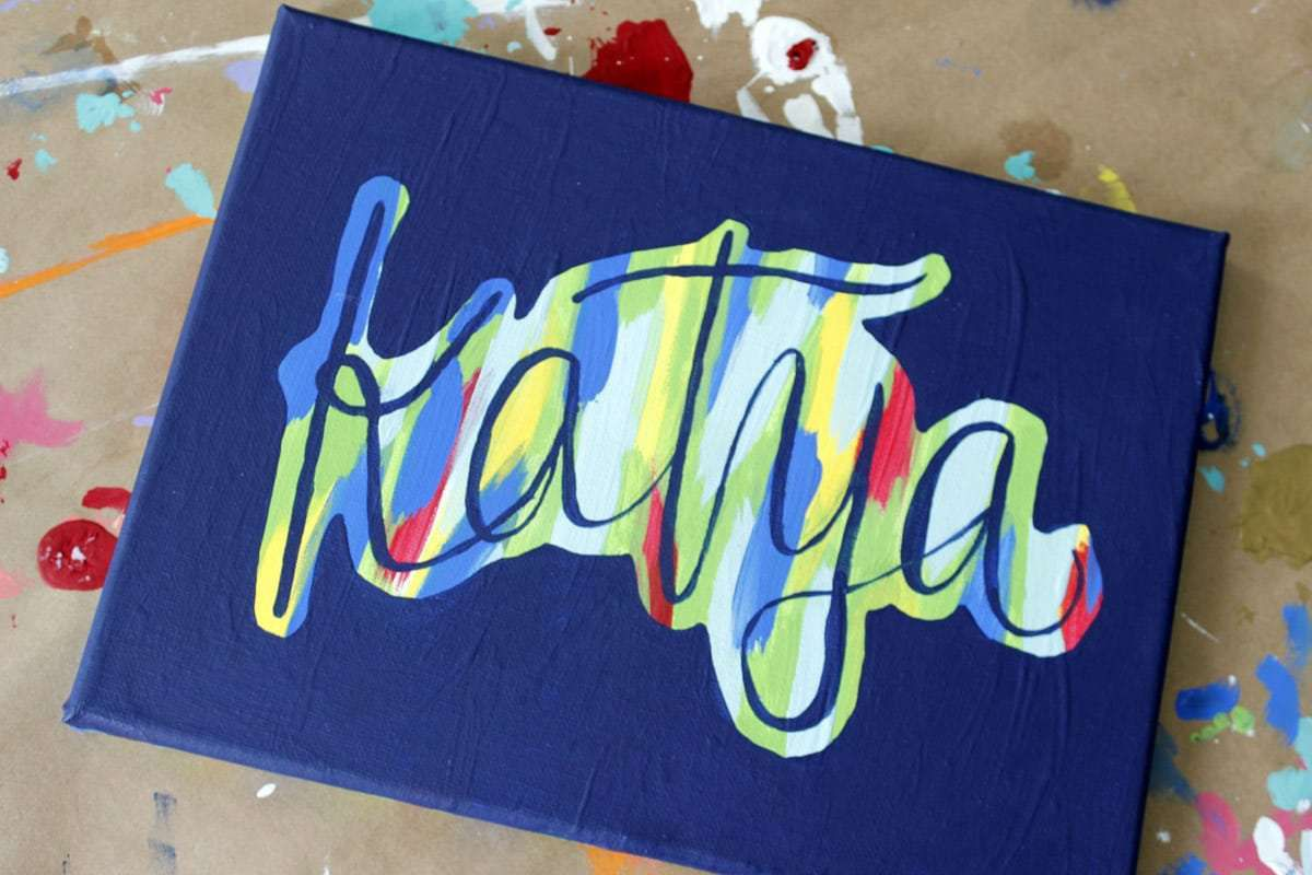 Colorful painted letters on canvas.