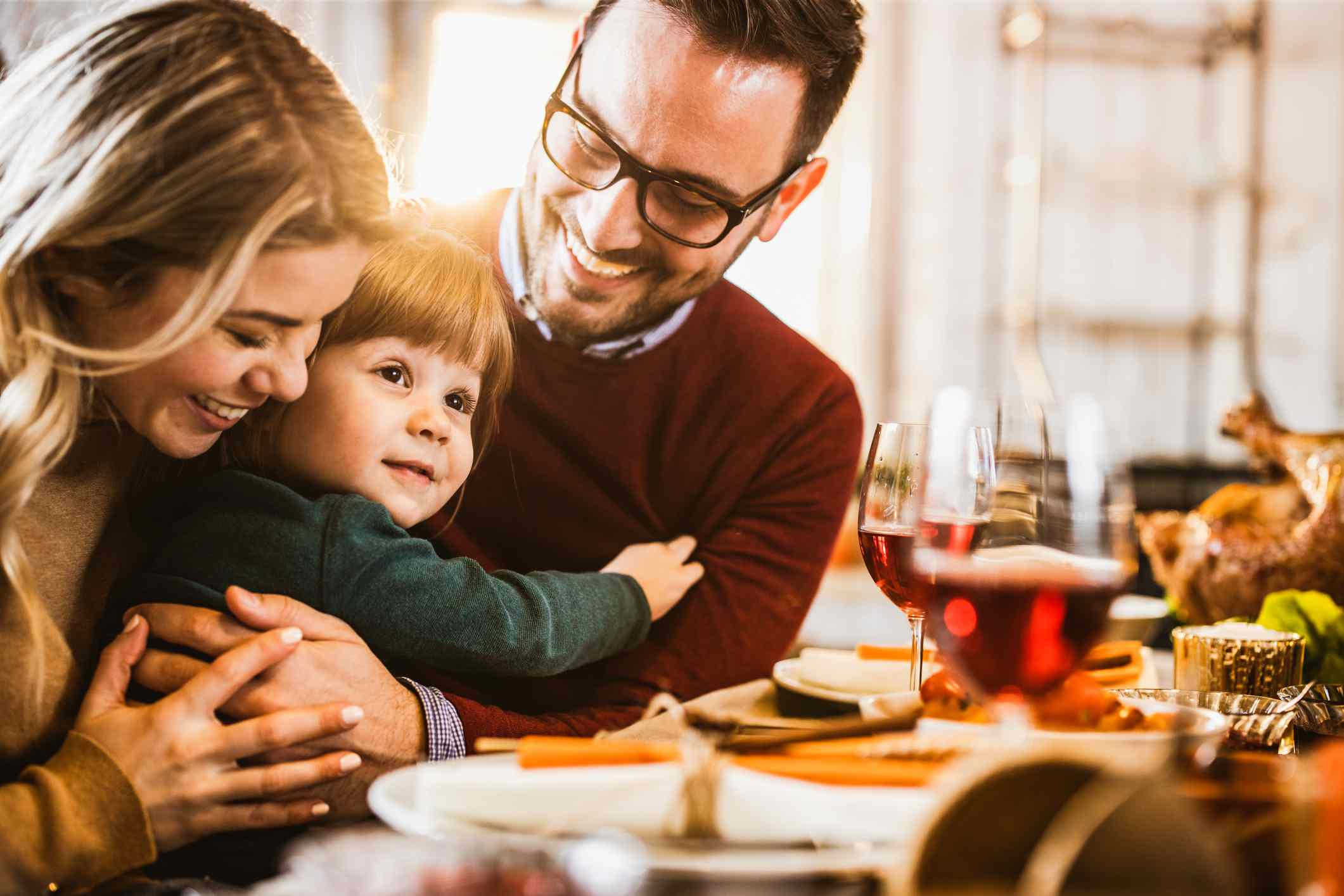 Young loving family enjoying in their time at dining table