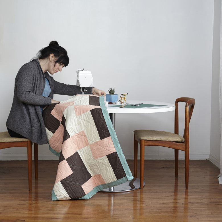 Woman quilting on a sewing machine
