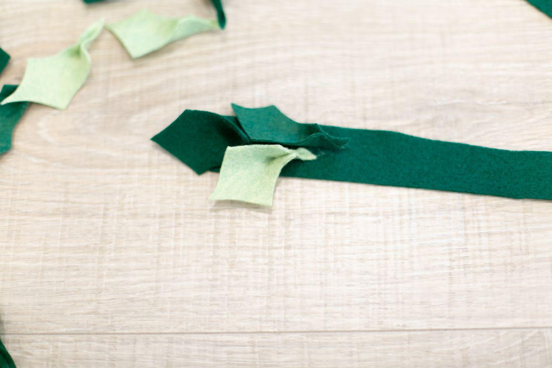 glueing leaves for felt holly garland