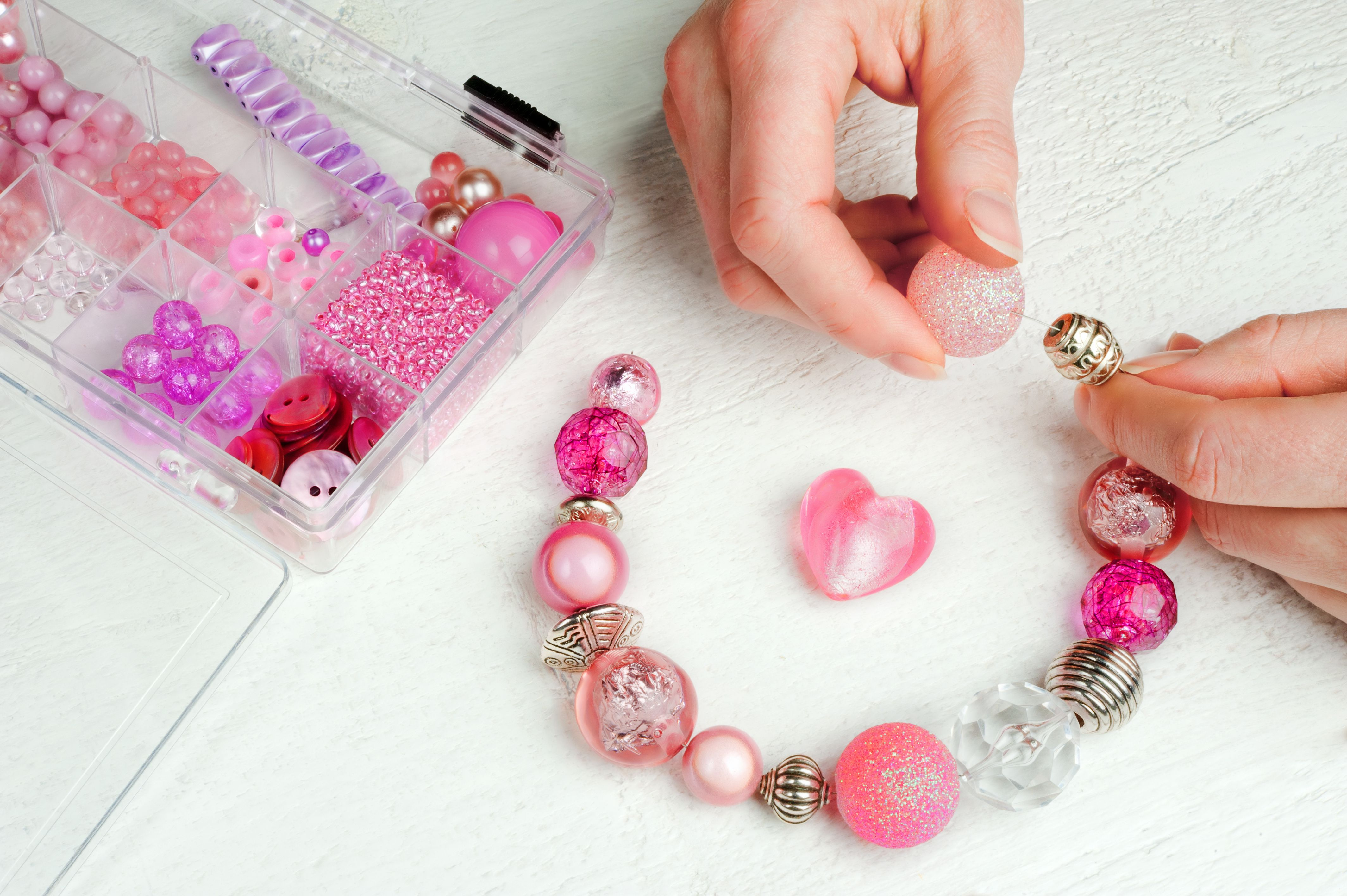 Hobbyist homemaking beaded jewelry