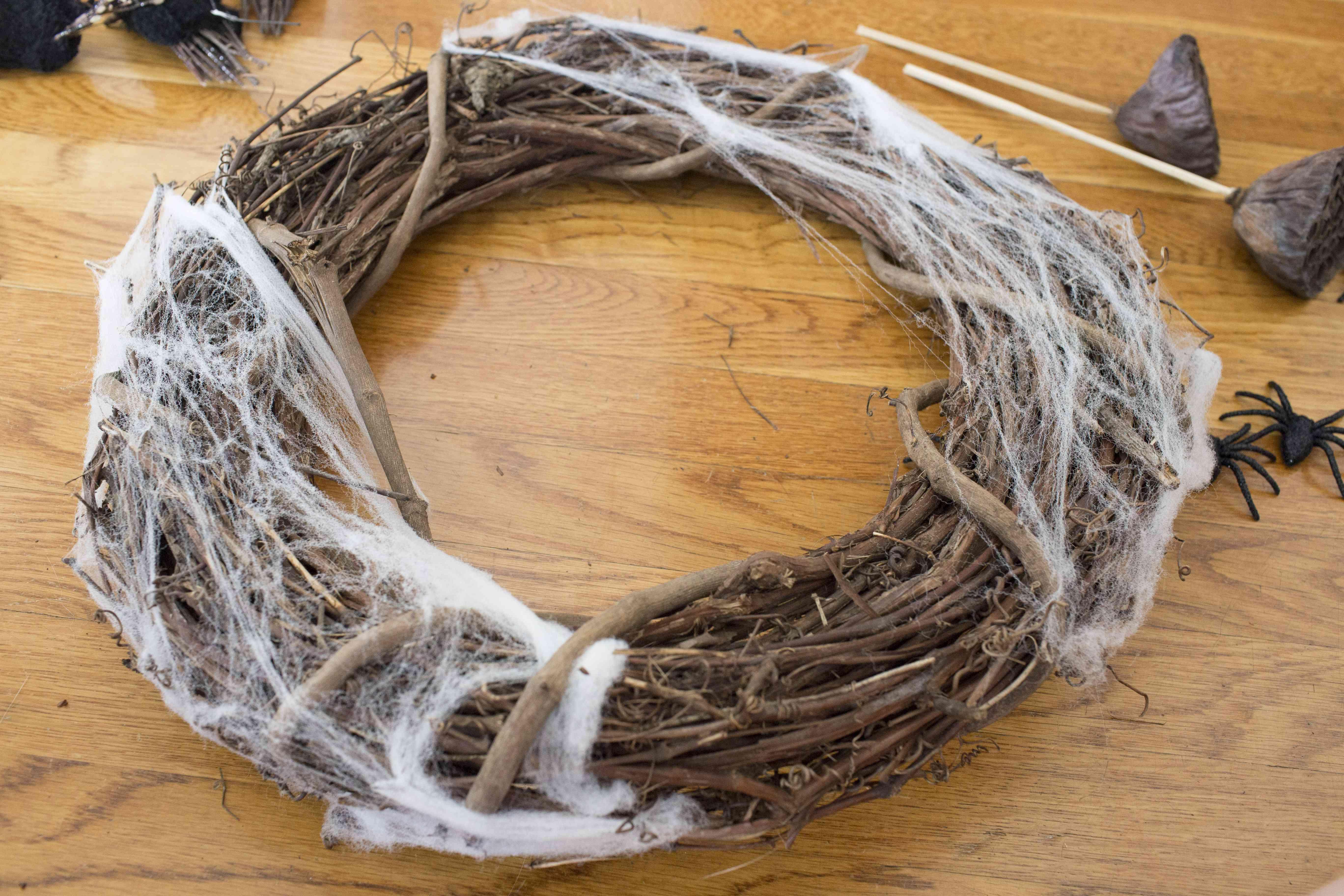 Add cobwebs to the wreath.