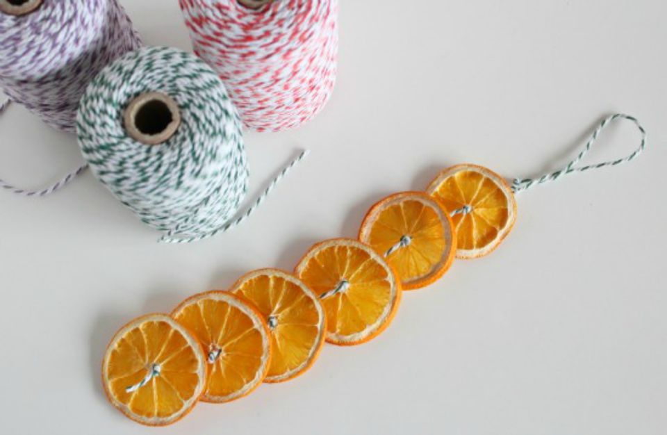 oranges strung on yarn