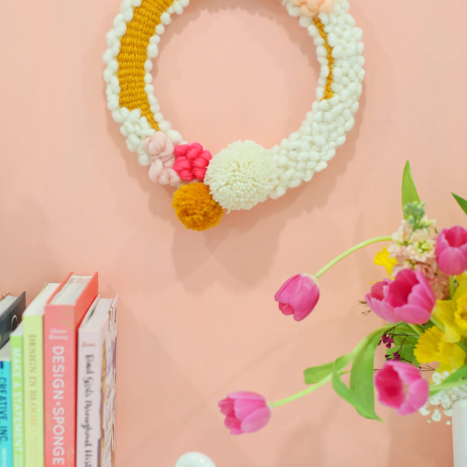 wreath made with yarn and pompoms